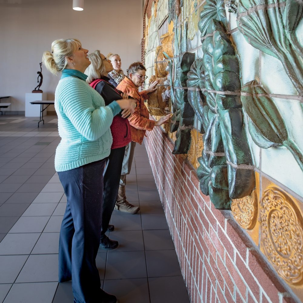 Spectators admire art at The Portland Center of Arts Place in Jay County, Indiana