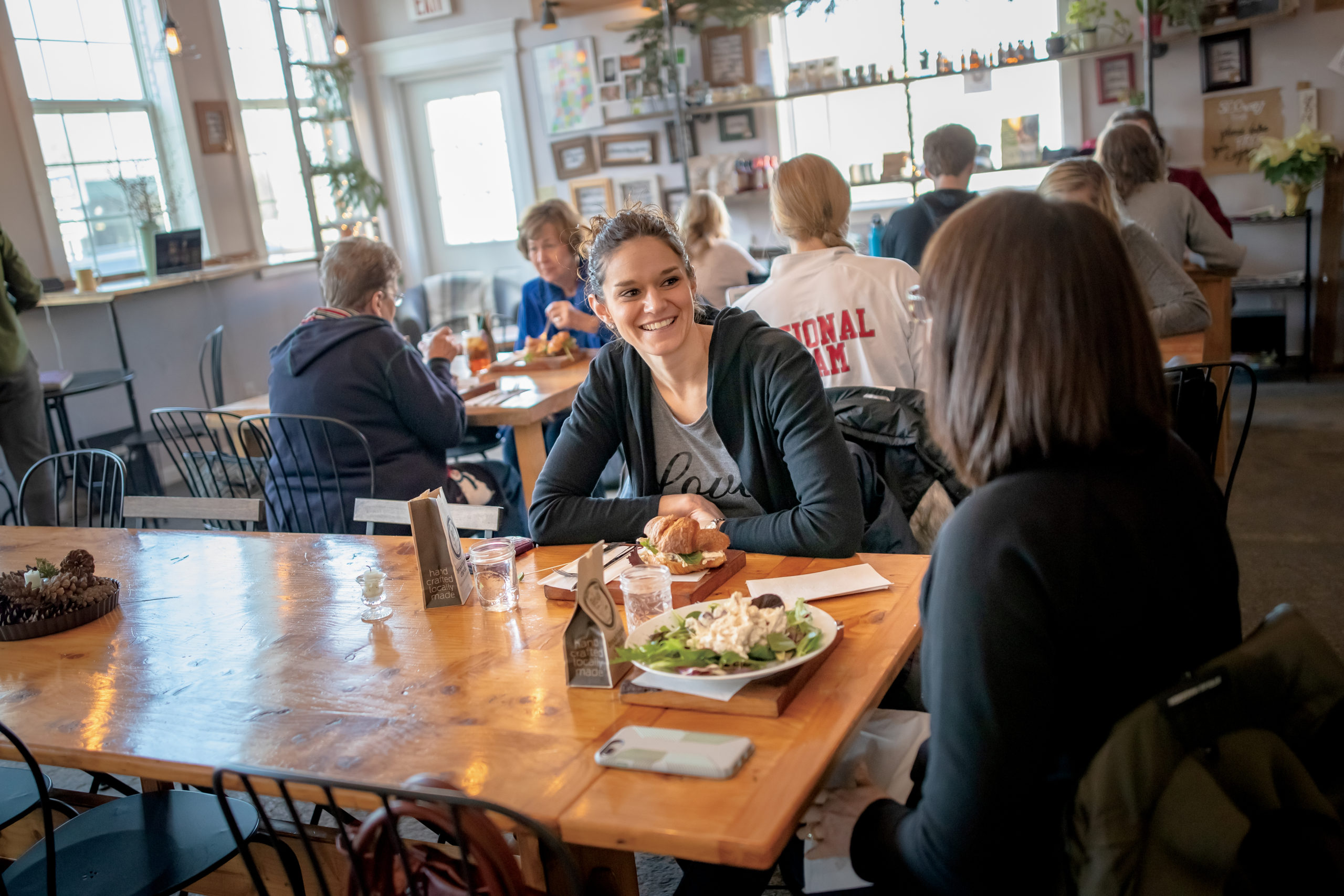 Customers talking and enjoying lunch at The Bridge Café in Upland, Indiana