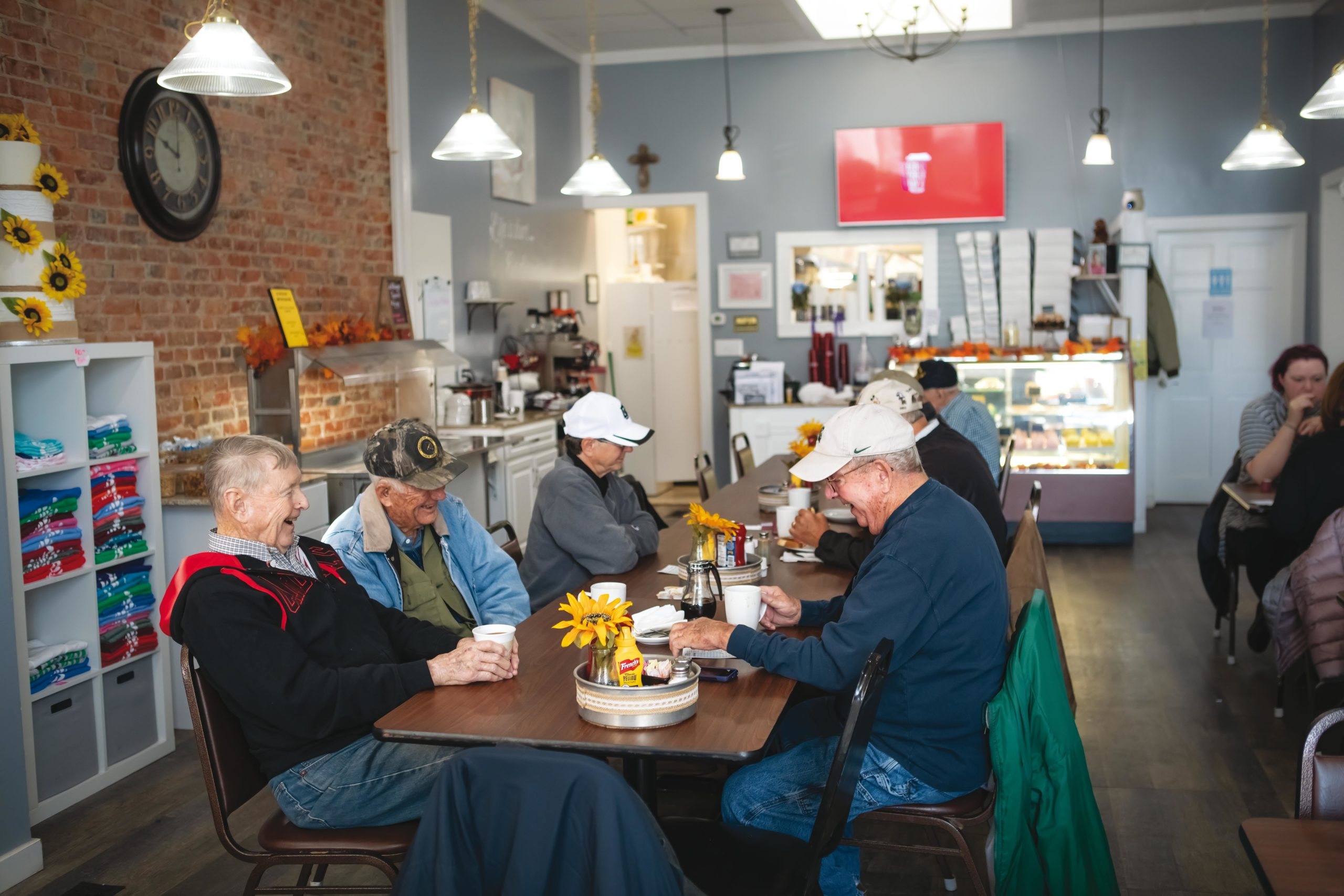 Randall Miller, Morris Lewman and Tom Haase are talking and lauging while having coffee at The Burch Tree Cafe and Bakery in downtown Knightstown, Indiana