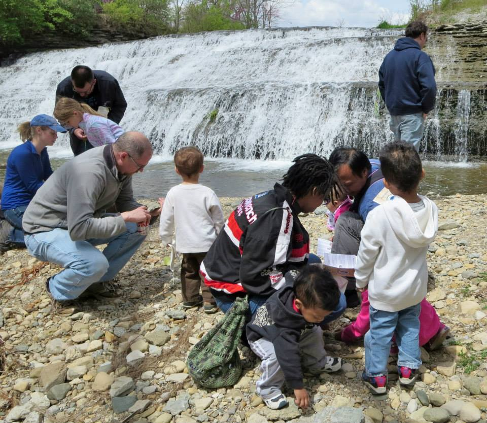Children and their parents discovering fossils in Richmond, Indiana at a Whitewater Valley Fossil Hunt