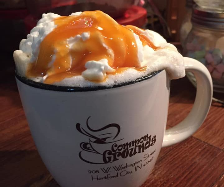 Cup of coffee with whipped cream and caramel at Common Grounds in Hartford City, Indiana