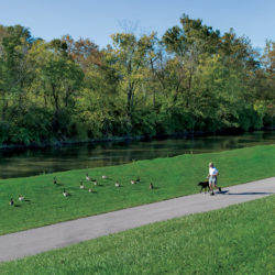 Man jogs with dog along the Cardinal Greenway in Delaware County, Indiana