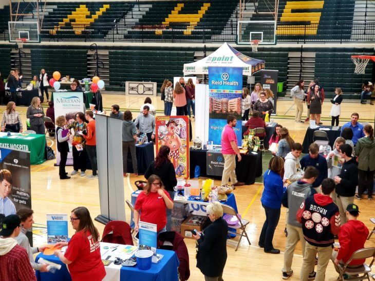 A job fair held in a highschool gym in East Central Indiana