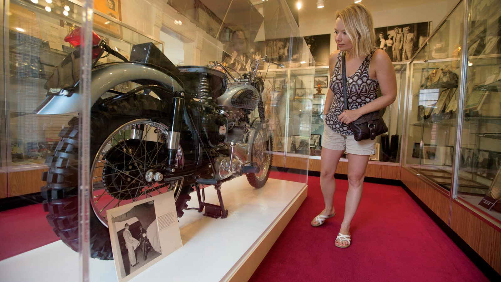 Woman looking at car at Fairmount Historical Museum