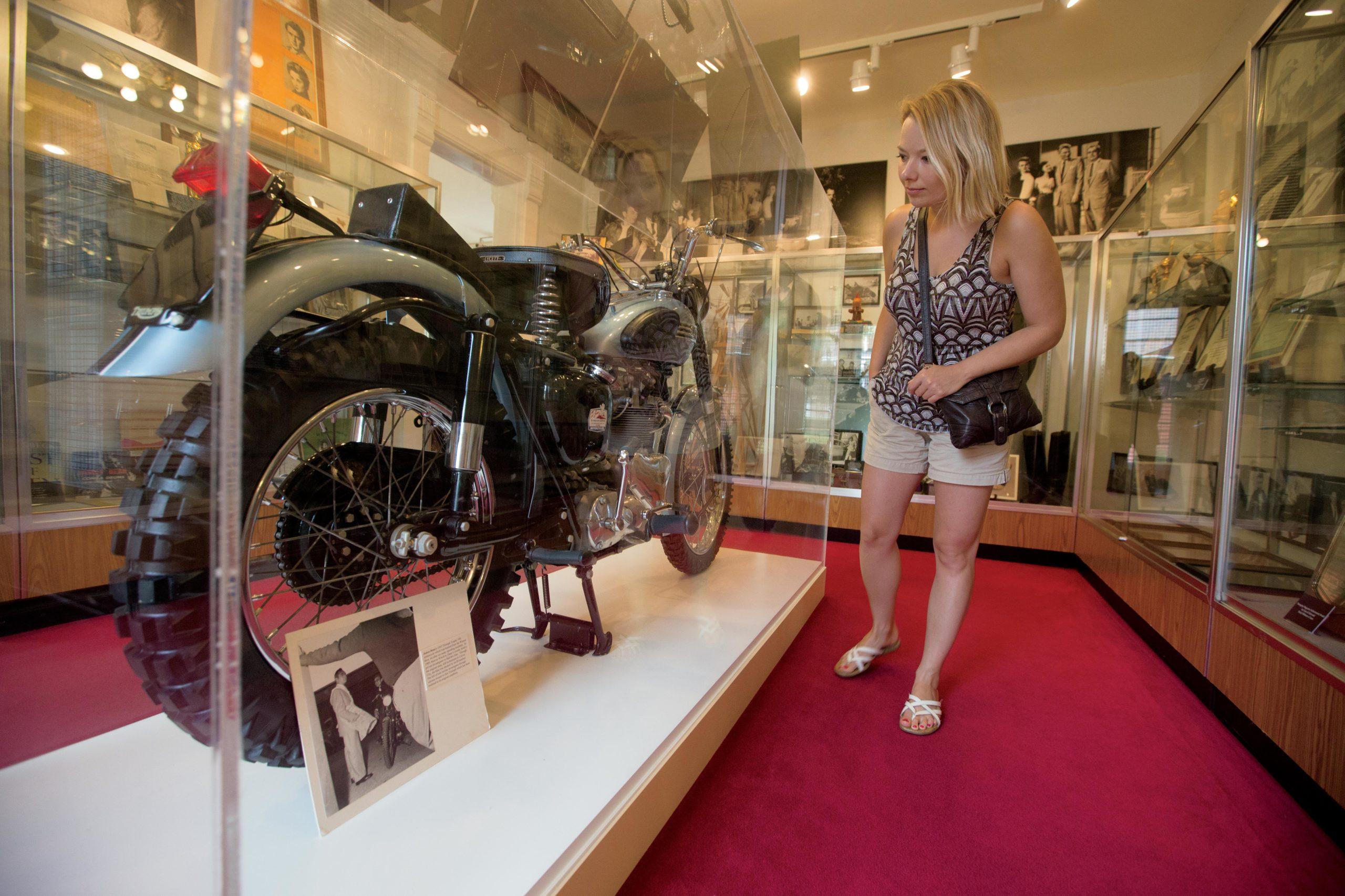 Woman looking at car at Fairmount Historical Museum
