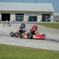 Riders in go-karts at New Castle Motorsports Park in East Central Indiana