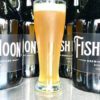 Growlers and a glass of beer from Fish Moon Brewing Company in Rushville, Indiana