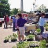 Customers browsing vendor tables at Hartford City Growers and Makers Market in East Central Indiana