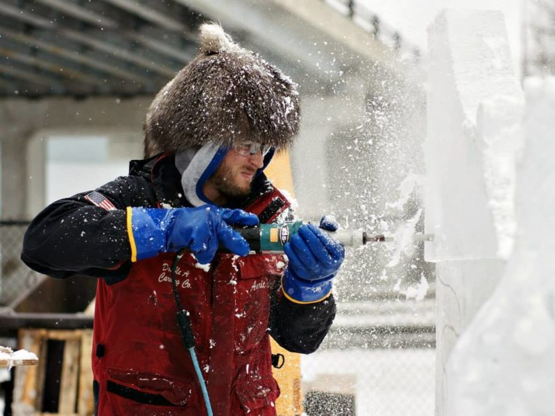 Man carving ice sculpture at Richmond Meltdown Winter Ice Festival in Indiana