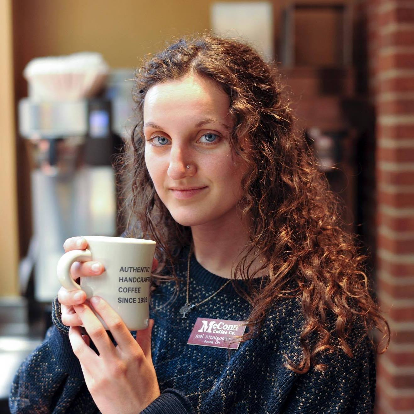 Mikayla Mirazzi with mug of coffee
