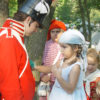Children and boy dressed as soldier at the Mississinewa 1812 event in Grant County, Indiana