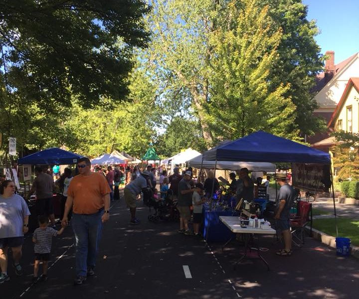 People and street vendors at Old Washington Street Festival in Muncie, Indiana