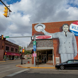 Mural of Wendell Willkie on the side of a brick pharmacy in Rushville, Indiana